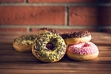 various donuts on wooden table
