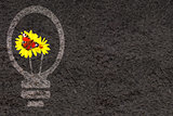 Eco background with soil and light bulb silhouette
