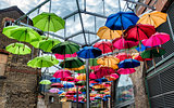 Umbrellas in many colors hanging in open air