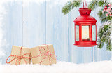 Christmas candle lantern, gift boxes and fir tree