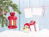 Christmas candle lantern, gift box and blank photos
