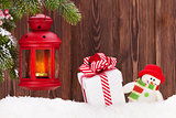 Christmas candle lantern, gift box and snowman