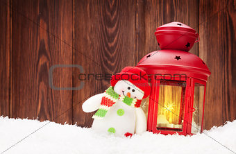 Christmas candle lantern and snowman toy