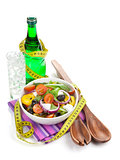 Fresh healthy salad, glass of water and kitchen utensil