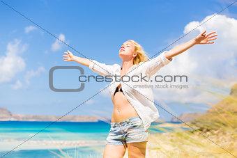 Free Happy Woman Enjoying Sun on Vacations.