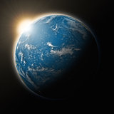 Sun over Pacific Ocean on planet Earth