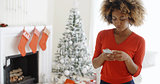 Young woman checking her Christmas messages