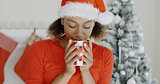 Young woman enjoying hot coffee at Christmas