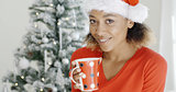 Young girl enjoying coffee on Christmas Day
