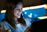 Young Student Using Tablet PC Indoor At Night