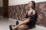erotic girl drinking champagne
