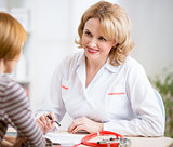 Doctor woman friendly talking to patient in her office