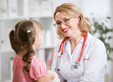 Pediatrician doctor examining kid