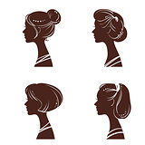 Four silhouettes of women