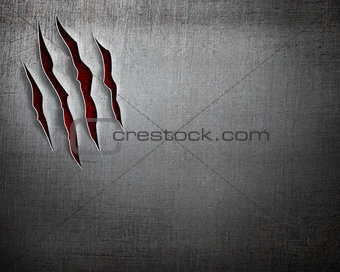 claw cuts on scratched metal background
