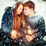Couple with Holiday Sparklers Celebrating Christmas