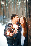 Happy Couple Celebrating Christmas in Forest