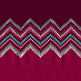 Seamless knitted pattern. Style blue yellow red white christmas