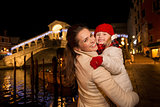 Smiling mother and daughter near Rialto Bridge Christmas Venice