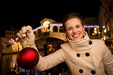 Woman with Christmas Ball near Rialto Bridge in Venice, Italy