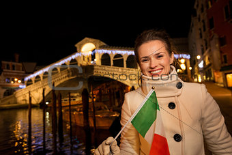 Tourist woman with Italian flag spending Christmas in Venice