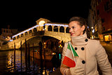 Woman with Italian flag having fun Christmas time in Venice