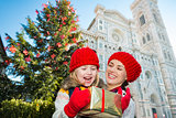 Mother and daughter excited about Christmas gift in Florence