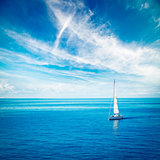 White Yacht Sailing in Blue Sea