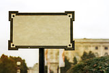Old blank sign a blur background of the city