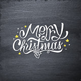 Merry Christmas handdrawn greetings on chalkboard