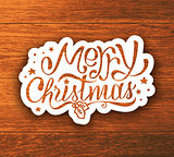 Merry Christmas hand lettering sticker on wood