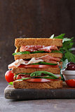 sandwich of rye bread with ham and vegetables