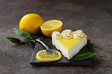 homemade baked lemon tart cake with meringue cream