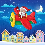 Christmas town with Santa Claus in plane