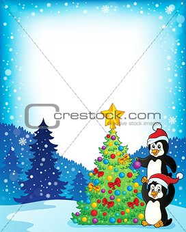 Frame with penguins near Christmas tree