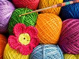 Crochet hook with a ball of yarn