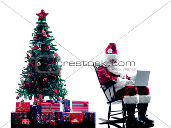 santa claus laptop computer  silhouette isolated