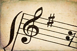 treble clef on vintage music sheet