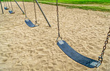 empty swings in playground