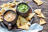 Bowl of queso with tortilla chips