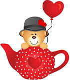 Teddy bear in red tea pot with heart balloon