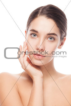 Portrait of female model with her hands near face