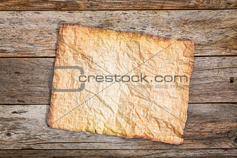 crumpled sheet of antique paper