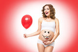 Pregnant woman with air balloon