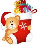 Teddy bear holding Christmas stocking with gifts
