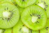 Many slices of kiwi fruit.