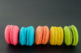 Row of french colorful macaroons.