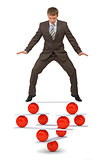 Businessman on balance balls