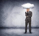 Sad businessman with cloud above head