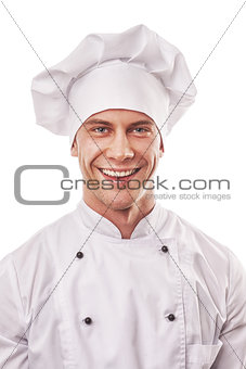 standing smiling male cook in white uniform and hat